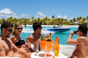 Guests moored off Jumby Bay drinking Champagne